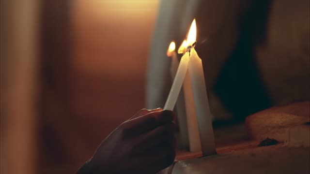 lighting candles in ancient temple - ceremony stock videos & royalty-free footage