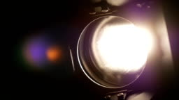 Lighting equipment, flash or spotlight, on and off, black, close up