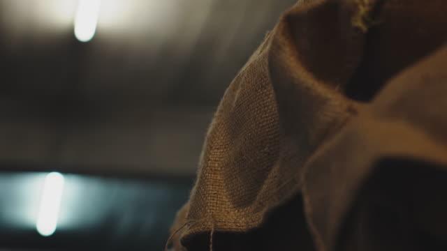 stockvideo's en b-roll-footage met verlichtingsapparatuur krijgt licht in magazijn - koffie drank