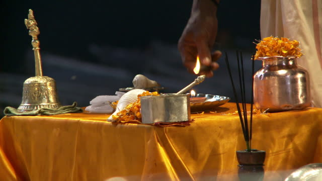 lighting incense for religious ceremony - dhoti video stock e b–roll