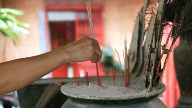lighting incense sticks - temple body part stock videos and b-roll footage