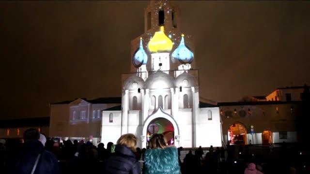 3D lighting on Kazan Kremlin's Spasskaya Tower is seen on December 23 2015 in Kazan the capital of the Autonomous Republic of Tatarstan on December...