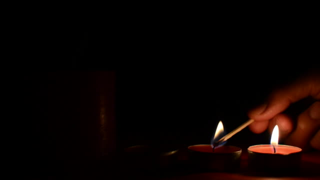 lighting the christmas candles - candle stock videos & royalty-free footage