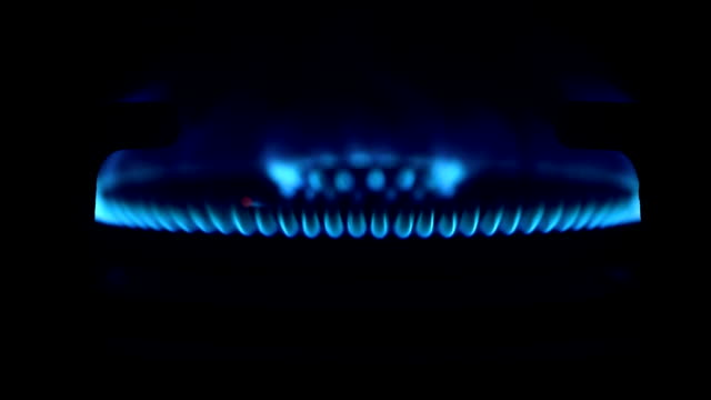 lighting the stove. gas burning on the stove. tunr on and turn off - hob stock videos & royalty-free footage