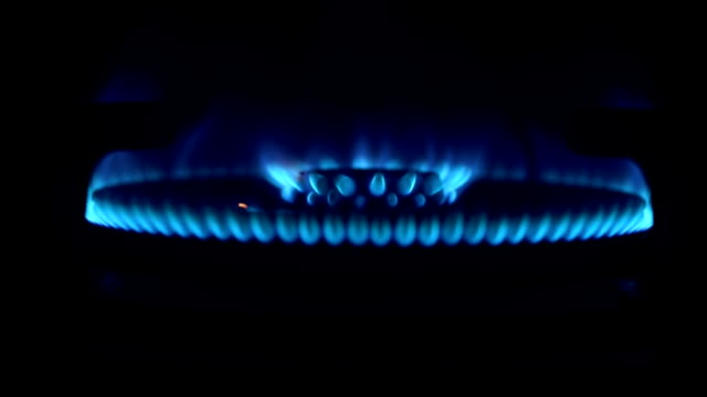 lighting the stove. gas burning on the stove. - gas stove burner stock videos and b-roll footage