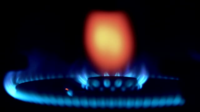 ecu lighting the stove. gas burning on the stove. - gas stove burner stock videos and b-roll footage