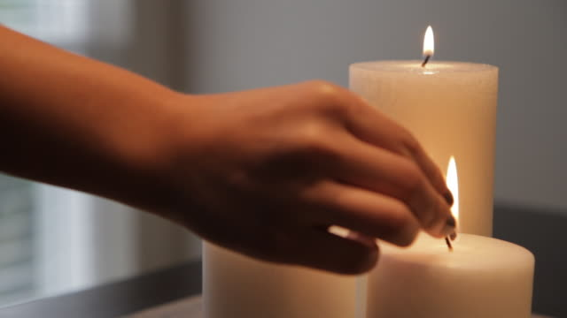 lighting three candles - candlelight stock videos and b-roll footage