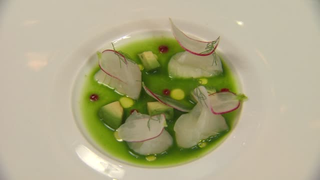 lightly cured fluke perked up with seethrough radish slices and tiny dots of fermented chili paste at intro chicago restaurant in chicago on feb 25... - douglas fir stock videos and b-roll footage