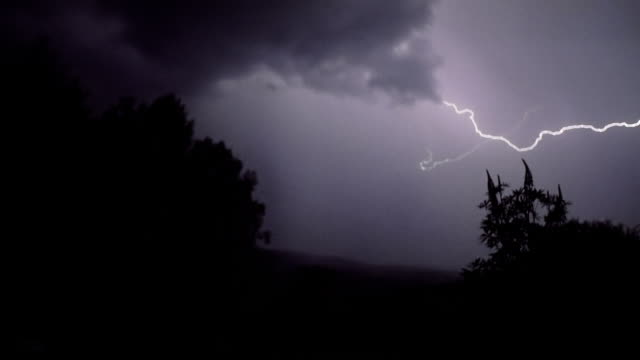 lightning above the forest - atmospheric mood stock videos & royalty-free footage