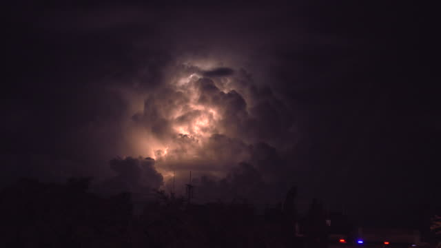 lightning behind cloud - lightning stock videos & royalty-free footage