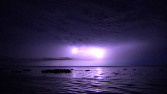 ws lightning bolts in sky over sea at night / san carlos de zulia, zulia, venezuela - venezuela stock videos & royalty-free footage