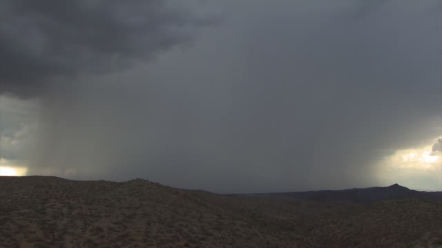 lightning bolts in very heavy rain shower over mountains. sonoran desert near tucson, arizona, usa - monsoon stock videos and b-roll footage
