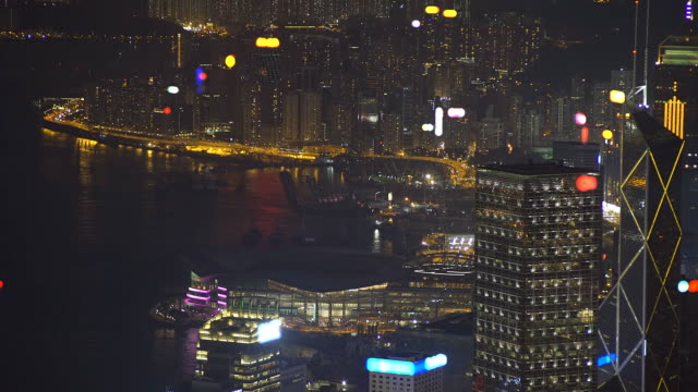 lightning bolts over the skyline and harbor of hong kong - hsbc main building stock videos and b-roll footage