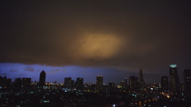 lightning dramatic sky with cityscape at night - roof stock videos & royalty-free footage