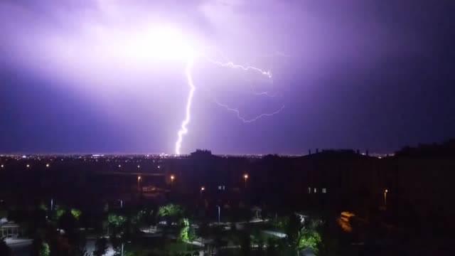 vidéos et rushes de lightning flashes illuminate the sky during a heavy rainfall in turkey's central konya province on june 09, 2019. - éclair