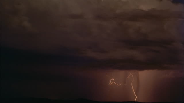 Lightning flashes in a cloudy, foreboding sky.