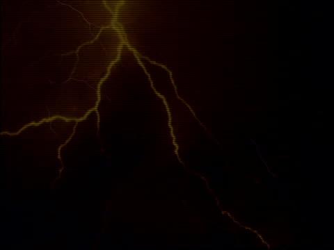 Lightning flashing in night sky