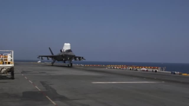 lightning ii's with medium marine tiltrotor squadron 262 carrying guided bomb units conduct flight operations from the uss wasp in philippine sea,... - fighter stock videos & royalty-free footage
