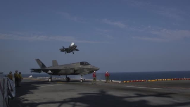 lightning ii's with medium marine tiltrotor squadron 262 carrying guided bomb units conduct flight operations from the uss wasp in philippine sea,... - 米国海軍点の映像素材/bロール