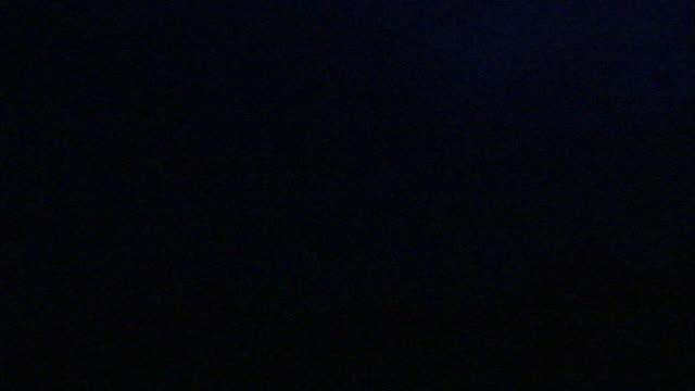 lightning illuminates the sky at night. - horizon stock videos & royalty-free footage