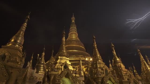 w/s long dolly track side lightning in shwedagon pagoda, yangon (myanmar), night - circa 6th century stock videos & royalty-free footage
