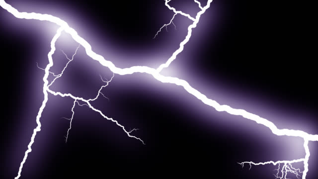 lightning piercing night sky 4k - lightning stock videos & royalty-free footage