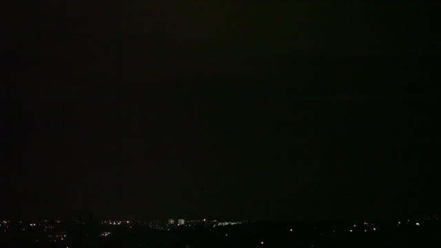 lightning storm over sandton cbd, johannesburg, south africa - パン効果点の映像素材/bロール