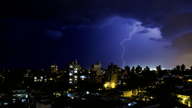 lightning storm over the city timelapse - lightning stock videos & royalty-free footage