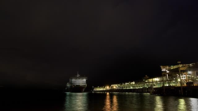 Lightning storm rolls in behind Spirit of Tasmania ferry departing dock