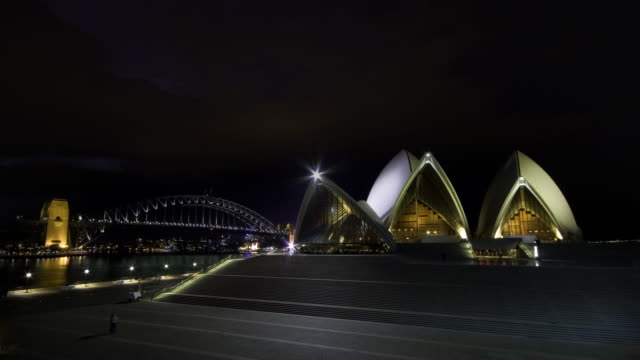 Lightning storm rolls in behind Sydney Opera House and Sydney Harbour Bridge