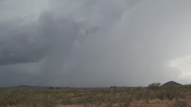 lightning strike over scrub land, arizona usa - lightning strike stock videos and b-roll footage