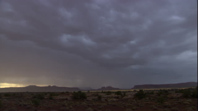 lightning strikes during a thunderstorm over the utah desert. available in hd. - thunderstorm stock videos & royalty-free footage