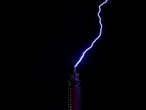 lightning strikes hitting tower - tesla coil stock videos and b-roll footage