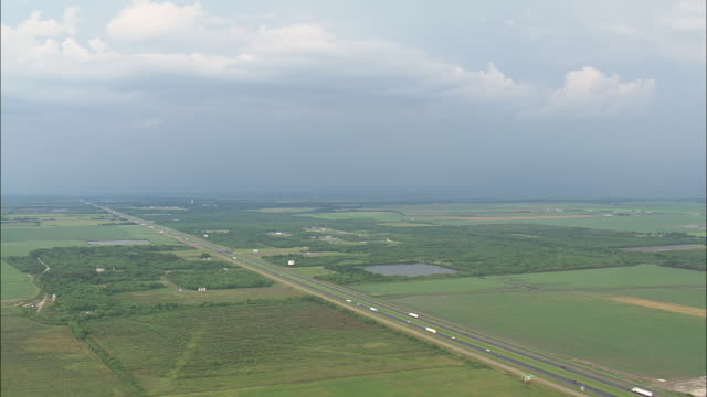 WS AERIAL Lightning strikes with ranches and farmland between highway / Texas, United States