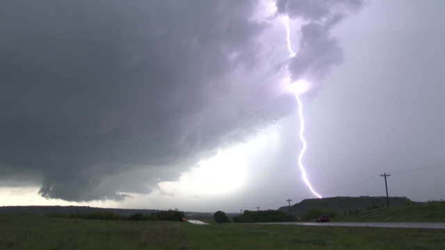 lightning striking the ground, rotating supercell thunderstorm & wall cloud - oklahoma stock-videos und b-roll-filmmaterial