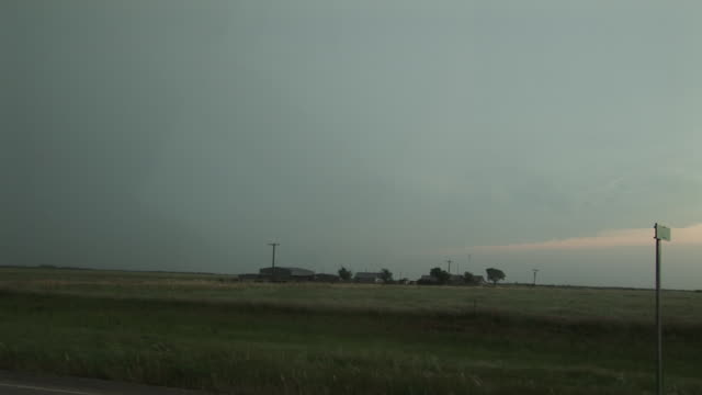Lightning under clouds, people watching forked lightning, WA, USA