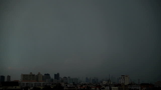 lightning with thunderstorm clouds over the bangkok cityscape. - ominous stock videos & royalty-free footage