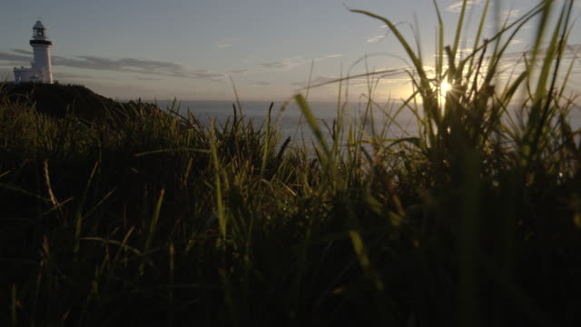 lightouse at dawn grass pov - steve munro stock videos & royalty-free footage