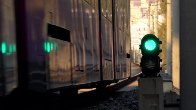 lightrail driving on track - railway signal stock videos & royalty-free footage