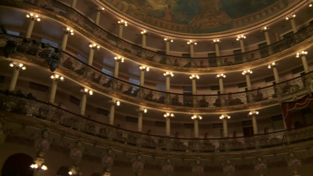 lights and columns highlight balconies in an opera house. - manaus stock videos and b-roll footage
