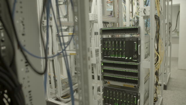 lights blinking on cloud computing system in rack at illuminated server room - silicon valley, california - ビッグデータ点の映像素材/bロール
