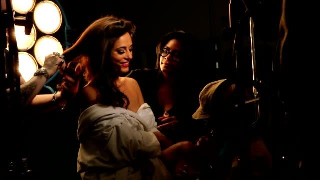 lights, camera & glamour model prep - fotografische themen stock-videos und b-roll-filmmaterial