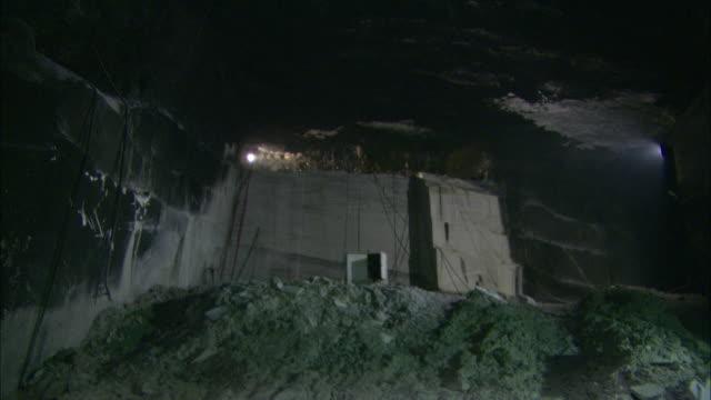 lights dimly illuminate a granite quarry in vermont. - granite stock videos & royalty-free footage