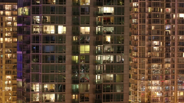 lights flash from a condominium building in toronto, canada. - toronto stock videos & royalty-free footage