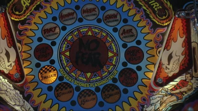 lights flash on a pinball machine. - pinball machine stock videos & royalty-free footage