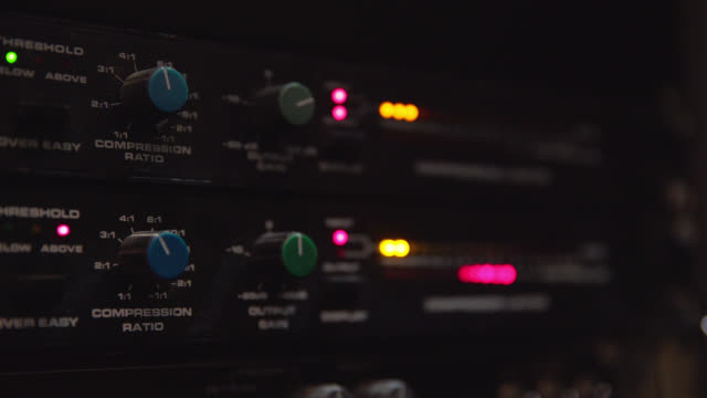 lights flashing on an audio mixing unit - electrical equipment stock videos & royalty-free footage
