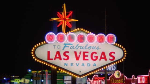 CU Lights flashing on Welcome To Fabulous Las Vegas Nevada Sign / Las Vegas, Nevada, USA