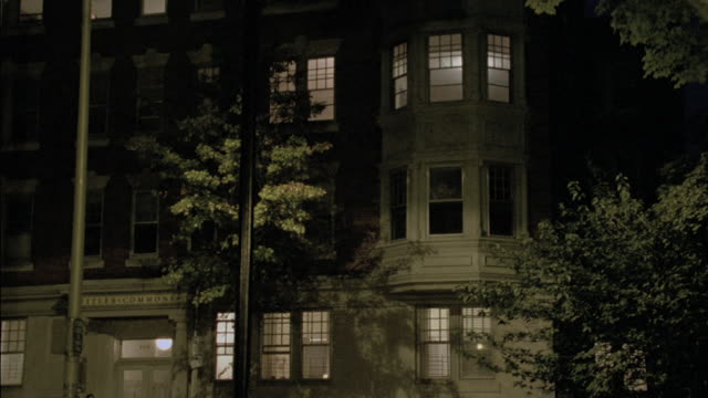 "lights glow from the ""fitler commons"" apartment building. - bay window stock videos & royalty-free footage"