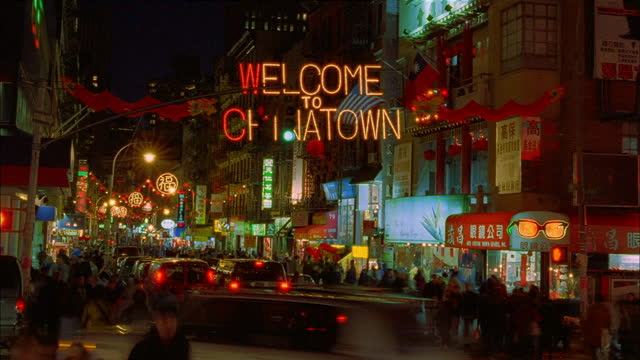 lights glow in new york's chinatown. - chinatown stock videos & royalty-free footage