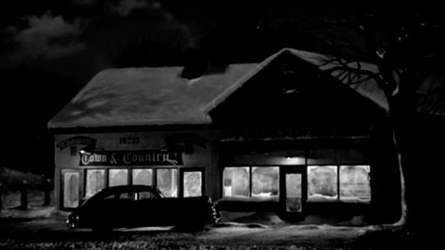 lights glow in the frosted windows of a roadside cafe. - 1949 stock videos & royalty-free footage